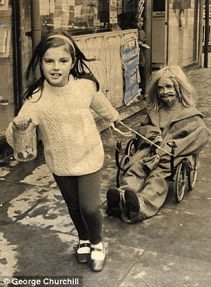 Laura Dale, seven, from Hampstead, pulls a pram chassis with a guy collecting for Bonfire Night in 1970.